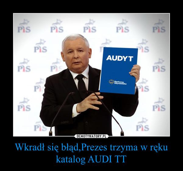 Wkradł się błąd,Prezes trzyma w ręku katalog AUDI TT –